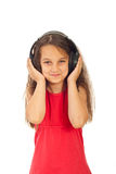 Smiling girl listening music Royalty Free Stock Photo