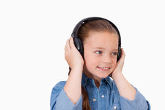 Smiling girl listening to music Royalty Free Stock Photos