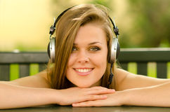 Smiling girl listening to music Royalty Free Stock Images
