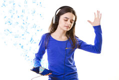 Smiling girl listening to music on digital tablet  Royalty Free Stock Photo
