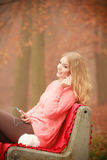 Smiling girl listening to music. Royalty Free Stock Photos