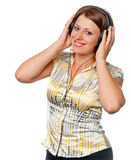 Smiling girl listens to music in ear-phones Stock Photography
