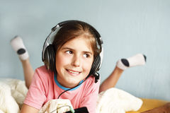 Smiling girl listens to music Stock Image