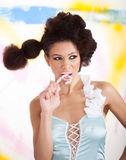Smiling girl with lollipop Stock Image
