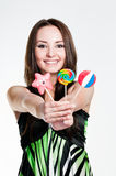 Smiling girl with lollipops Royalty Free Stock Photo