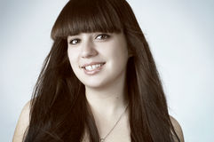 Smiling girl with long black hair, artistic image Stock Photos