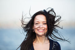 Smiling girl with long black hair Royalty Free Stock Photography
