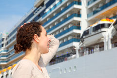 Smiling girl look at the big cruise ship Royalty Free Stock Photography