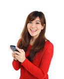 Smiling girl looking with mobile phone Stock Photos