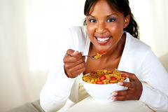 Smiling girl looking at you and having breakfast Stock Photo