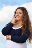 Smiling girl looks at camera at background of sky royalty free stock photos