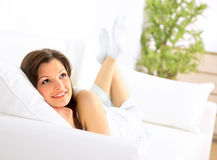 Smiling girl lying down Stock Photos