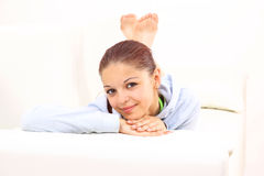Smiling girl lying down Royalty Free Stock Images