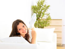 Smiling Girl Lying Down On Divan Royalty Free Stock Images