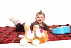 Smiling girl lying on floor. Royalty Free Stock Photo