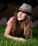 Smiling girl lying on the grass in the garden at n Royalty Free Stock Photos