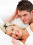 Smiling girl lying with her boyfriend Stock Photo
