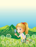 A smiling girl and a magnifier royalty free illustration