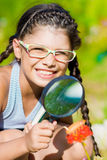 Smiling girl with magnifying glass Stock Photo
