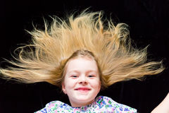 Smiling girl makes faces imitate witch. Cute beautiful girl makes faces imitate witch Royalty Free Stock Photography