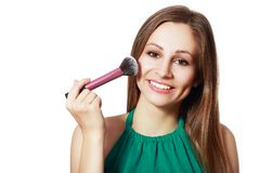 Smiling Girl with Makeup Brush Royalty Free Stock Image