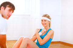 Smiling girl making abdominal crunch Royalty Free Stock Image