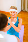 Smiling girl making abdominal crunch Royalty Free Stock Photos