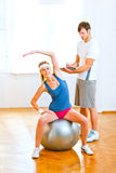 Smiling girl making exercises on fitness ball Royalty Free Stock Images