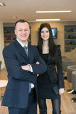 A smiling girl with a man in business suits standing Stock Photography