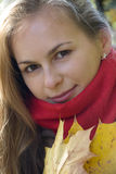 Smiling Girl with Maple Leaves Stock Photo