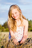 Smiling girl in meadow stock images