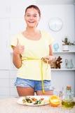Smiling girl measuring tape Stock Image