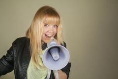 A smiling girl with a megaphone Stock Photos