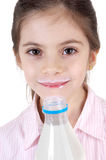 Smiling girl with milk Royalty Free Stock Image