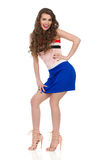 Smiling Girl In Mini Dress And High Heels Is Posing On Bent Legs Royalty Free Stock Photo