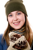 A smiling girl in mittens stock photo