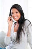 Smiling girl on mobile Royalty Free Stock Photos