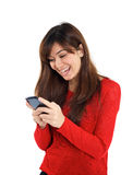 Smiling girl with mobile phone Royalty Free Stock Photography