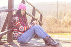 Smiling girl with mobile phone Royalty Free Stock Images
