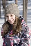 Smiling girl modeling in the snow stock image