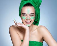 Smiling girl with moisturizing cream on her face. royalty free stock image