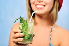 Smiling girl with mojito Stock Image