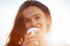 Smiling girl with morning coffee stock photos