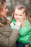 Smiling girl on mother's hands Royalty Free Stock Photography