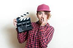 Smiling girl with movie clapper on white background Royalty Free Stock Images
