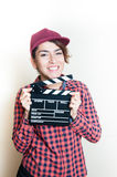 Smiling girl with movie clapper on white background Royalty Free Stock Photo