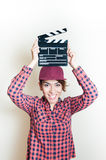 Smiling girl with movie clapper on white background Stock Image