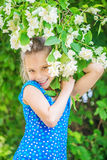 Smiling girl near blooming jasmine Stock Photography