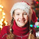 Smiling girl near christmas tree at home Stock Image