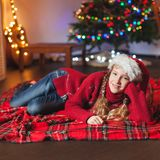 Smiling girl near christmas tree at home Royalty Free Stock Photo
